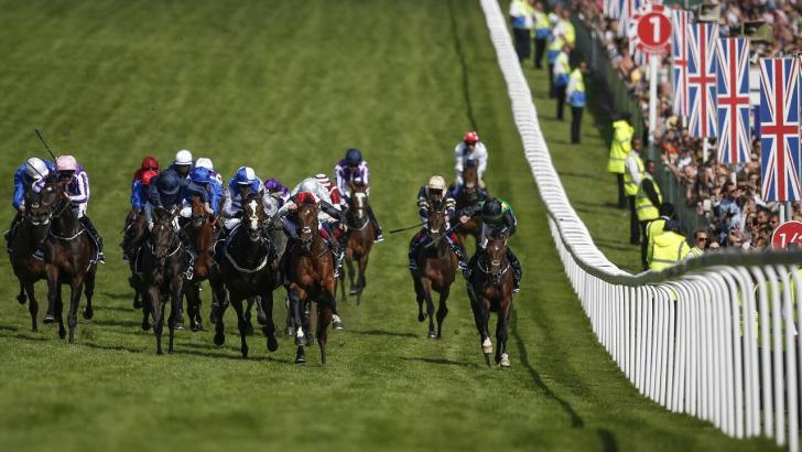 Runners in the final furlong of the Derby at Epsom