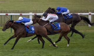 Godolphin jockey William Buick (centre) rides at Pontefract on Friday