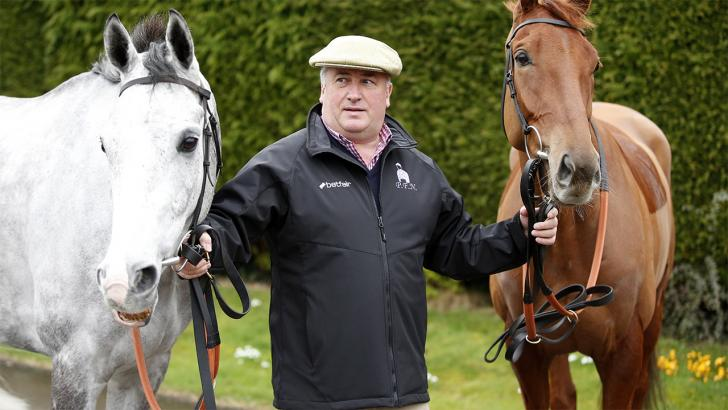 Paul Nicholls with two of his horses