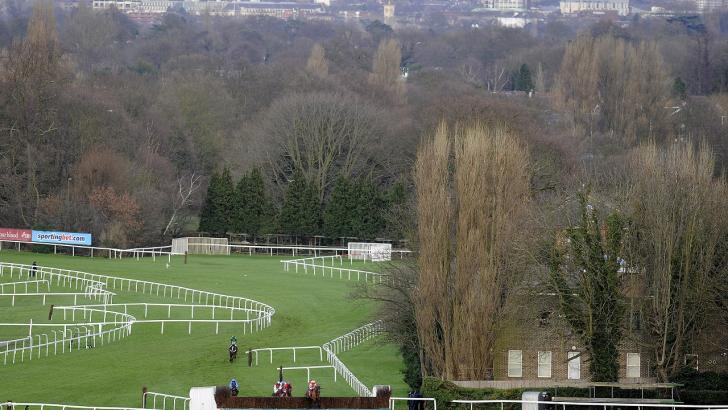 Horses jumping the Pond Fence at Sandown