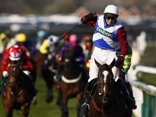 Derek Fox punches the air as he guides One For Arthur to Aintree Grand National success