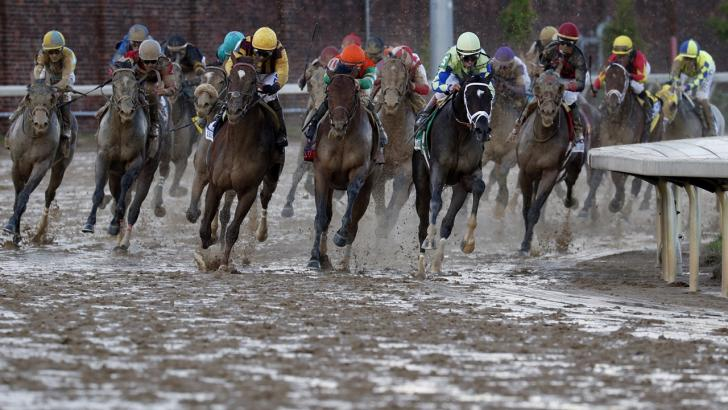 Horses race on dirt