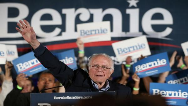 Bernie Sanders waves at rally.jpg