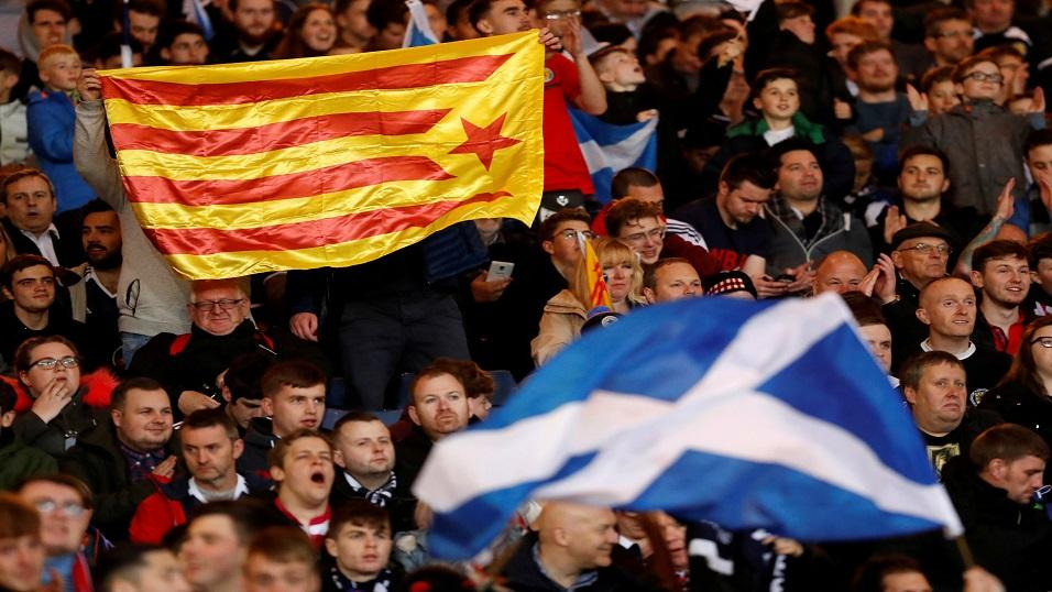 Football fans fly flags in support of Scottish and Catalonian independence