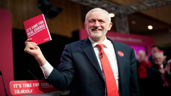 Jeremy Corbyn with manifesto.jpg