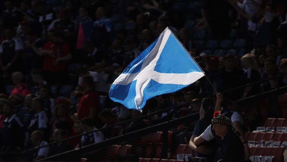 Scottish football supporters fly their flag