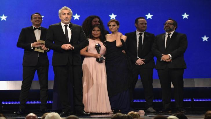Roma director Alfonso Cuaron and some of the film's cast