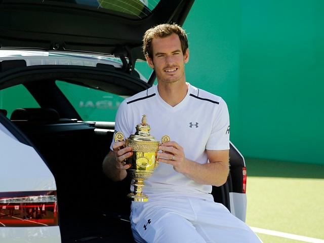 Andy Murray shows off his Wimbledon trophy