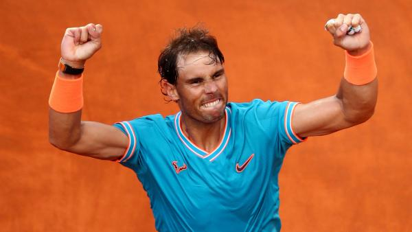 Rafa Nadal clay arms aloft 1280.jpg