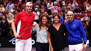 Tennis Players John Isner and Roger Federer