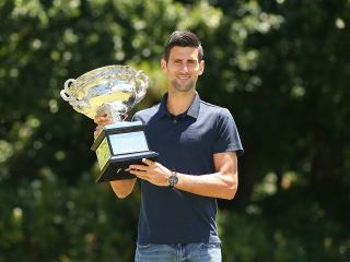 One down, four to go. Novak Djokovic shows off his Australian Open trophy.