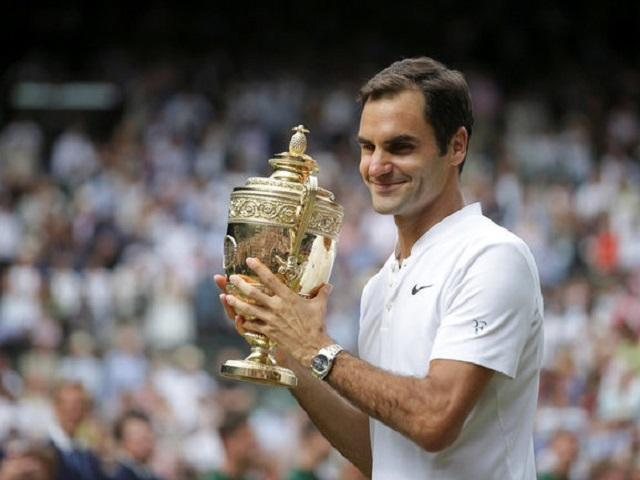 Roger Federer shows off his eighth Wimbledon trophy - how many more can he win?