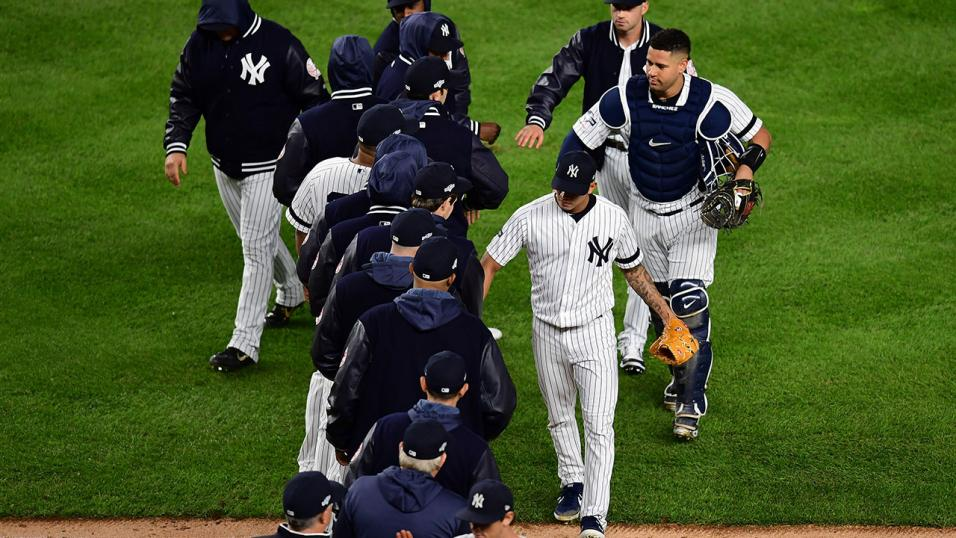 New York Yankees players congratulate each other